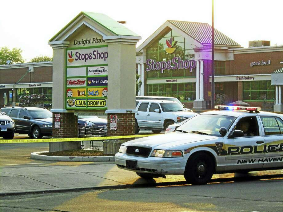 (Wes Duplantier/The New Haven Register)A large section of Whalley Avenue and the Stop & Shop plaza in New Haven were shut down early Friday for a police investigation. Police said two people had been shot, one of whom was seriously hurt. Photo: Journal Register Co. / Copyright 2009