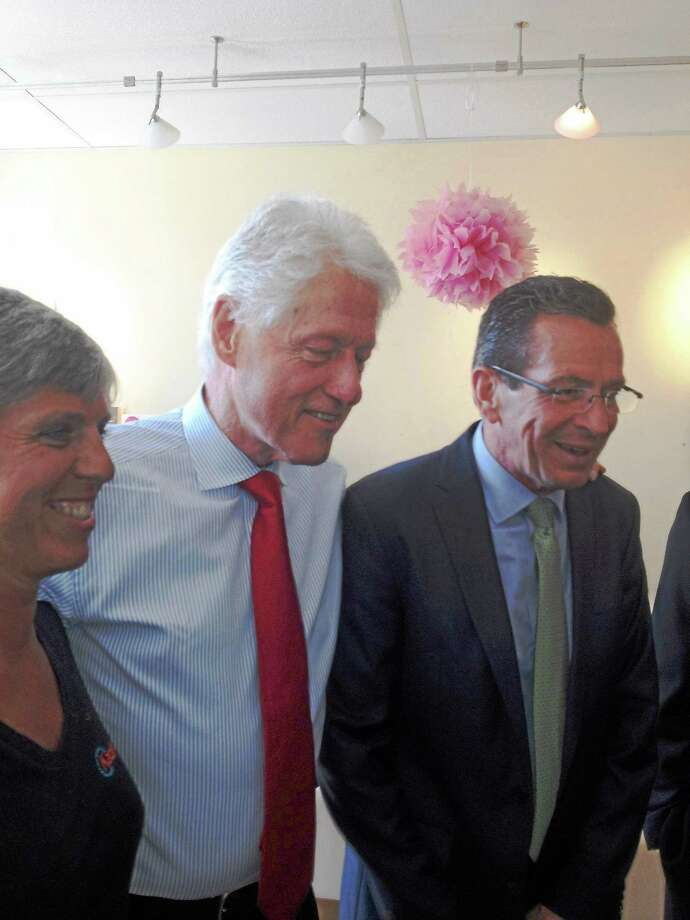 (Mary O'Leary - New haven Register) Kathy Riegelmann , former President Bill Clinton and Gov. Dannel Malloy Photo: Journal Register Co.
