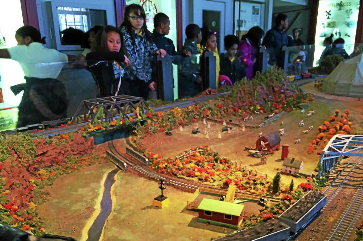 Students from the Roberto Clemente Leadership Academy in New Haven marvel at the toy trains at the Eli Whitney Museum in Hamden on Dec. 15. (Esteban L. Hernandez — New Haven Register)