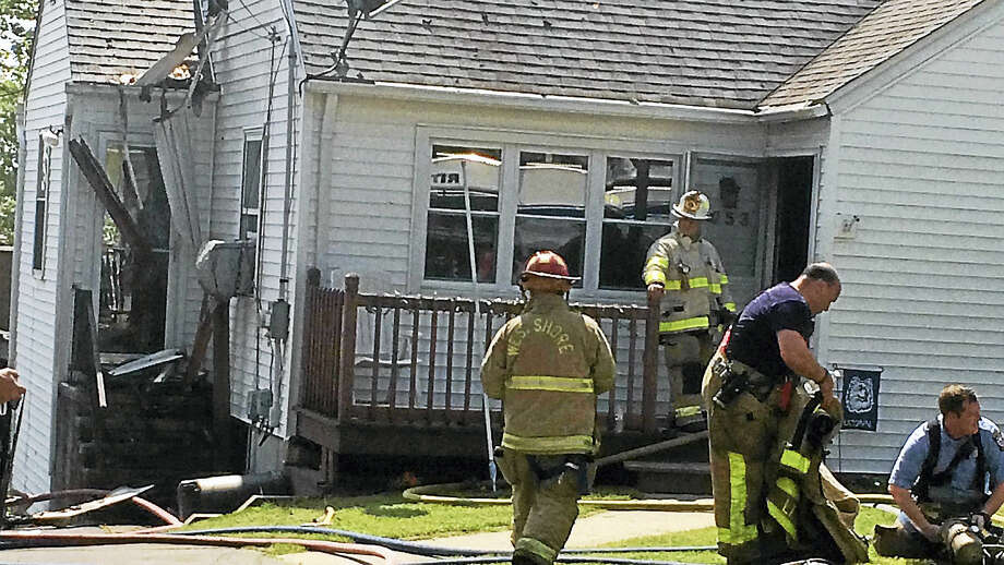 (Wes Duplantier - New Haven Register) One person escaped without injury and a West Haven home was heavily damaged after a fire broke out there late Thursday morning. Photo: Journal Register Co.