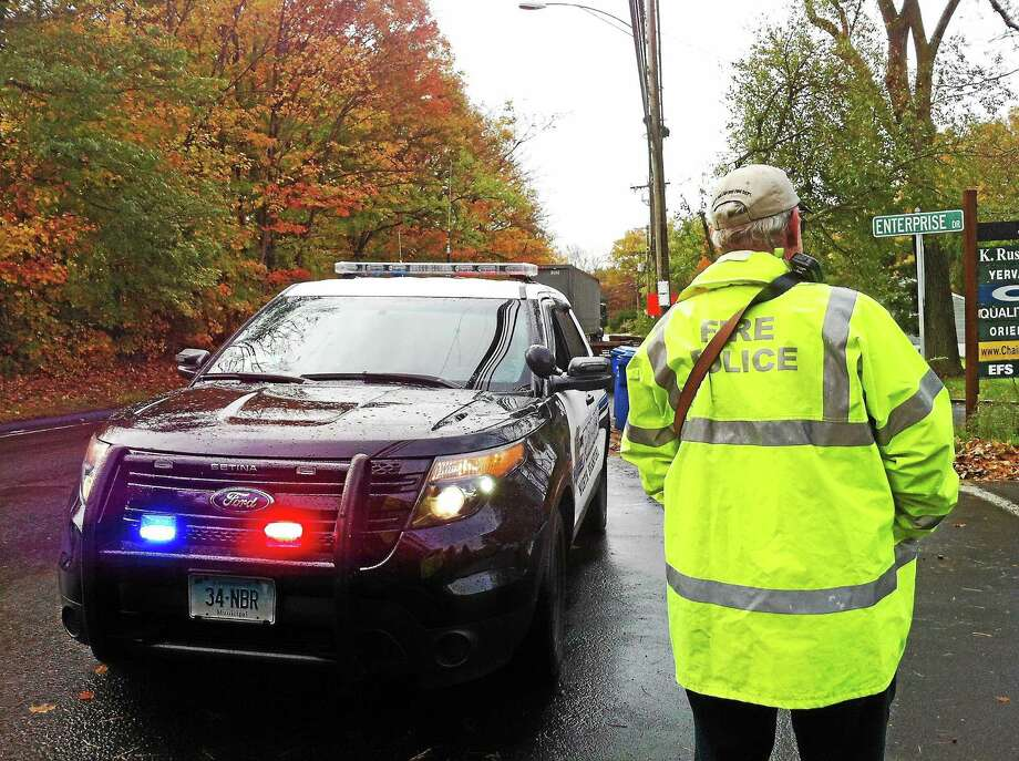 (Wes Duplantier-- New Haven Register) North Branford police and fire crews blocked off Enterprise Drive for a short time Friday morning after a construction crew hit a gas line, causing a leak. The leak was mostly stopped within two hours. Photo: Journal Register Co.