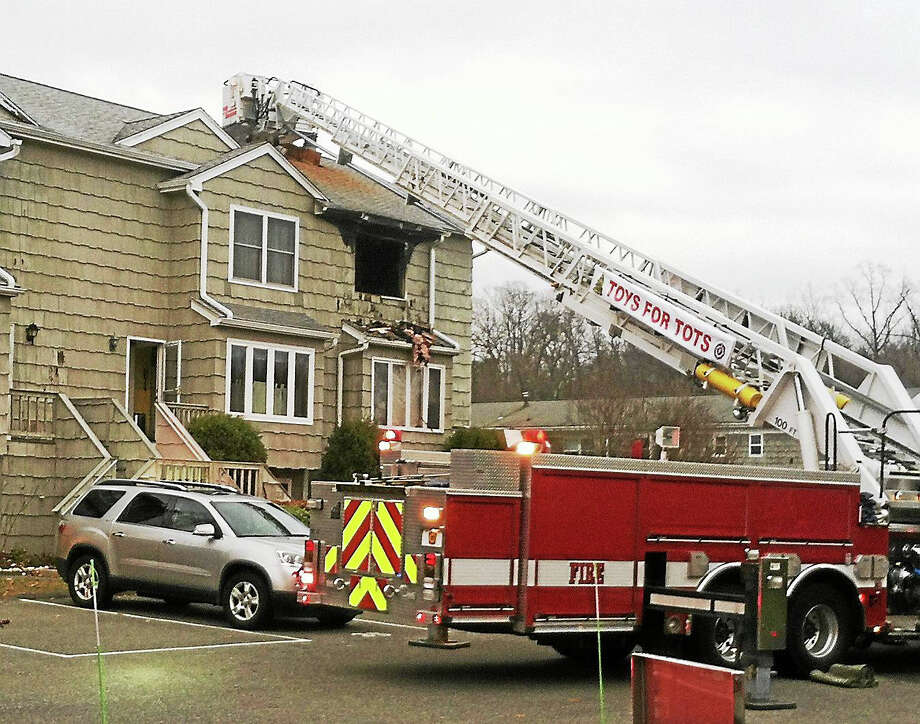 (Photo courtesy of the Milford Fire Department) A condominium on Southwind Lane in Milford was damaged when a fire broke out there Tuesday morning. No one was home at the time but a pet cat was rescued from inside the burning unit. Photo: Journal Register Co.