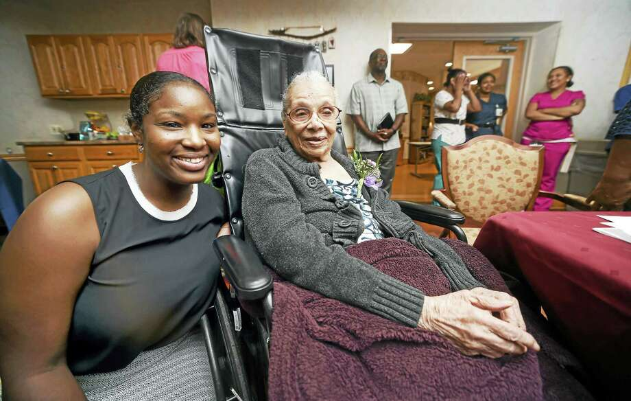 Joy Gary (left) of New Haven joined her great grandmother, Edna McCabe (center), 106, during a birthday party at Hamden Rehabilitation and Health Care Center in Hamden on 7/17/2017. Arnold Gold / Hearst Connecticut Media Photo: Digital First Media