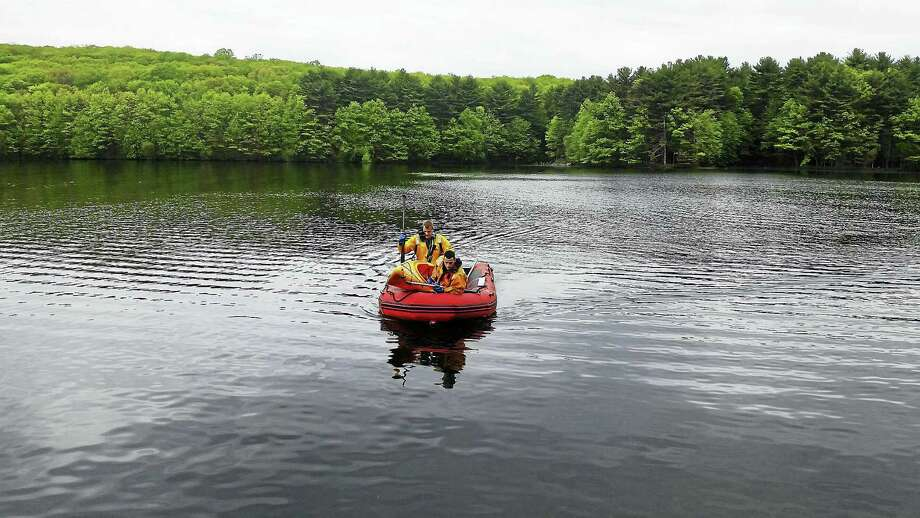 Photo courtesy of the Hamden Fire DepartmentHamden firefighters helped state and local police search part of West Rock Ridge State Park Thursday morning after a hiker reported seeing an overturned kayak in Lake Wintergreen. Photo: Journal Register Co.