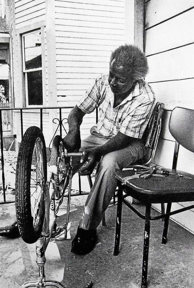 A dive into the annals of the Register indicates that the fight for commuter cyclistsí rights to the road started to surface during the mid-1980s. Here, a Newhallville resident is shown working on his bicycle in a photo taken in 1982 for a New Haven city guide. Photo: Journal Register Co.