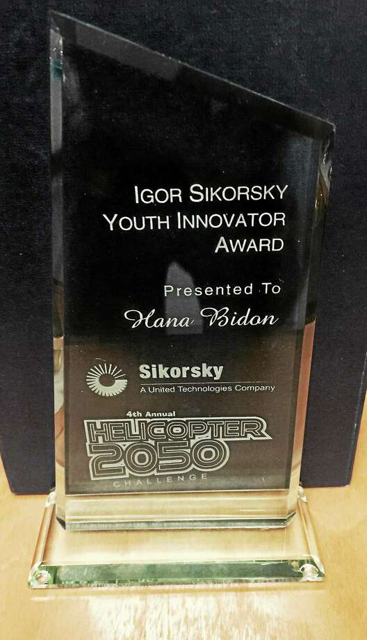 (Sikorsky photo) Hana Bidon's award. Bidon, a student at New Haven's Engineer & Science University Magnet High School, won the 2014 Igor Sikorsky Youth Innovator Award, top award among 400 entries in the national 2014 Sikorsky Helicopter 2050 Challenge. Photo: Journal Register Co.