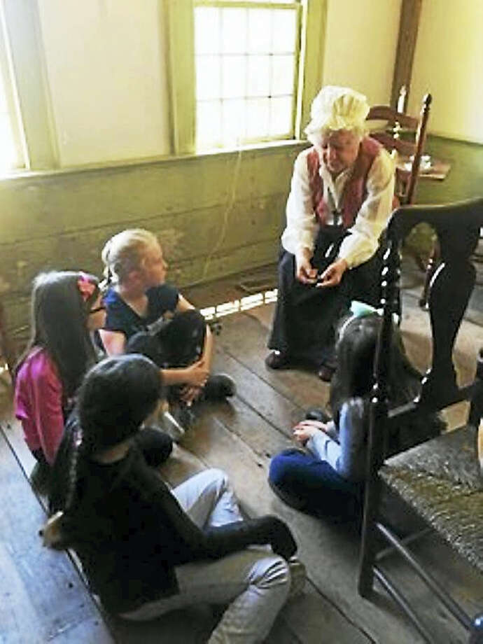 The Orange Historical Society staff recently welcomed second-graders to tour the 1740 Nathan Bryan-William Andrew house.Contributed photo Photo: Digital First Media