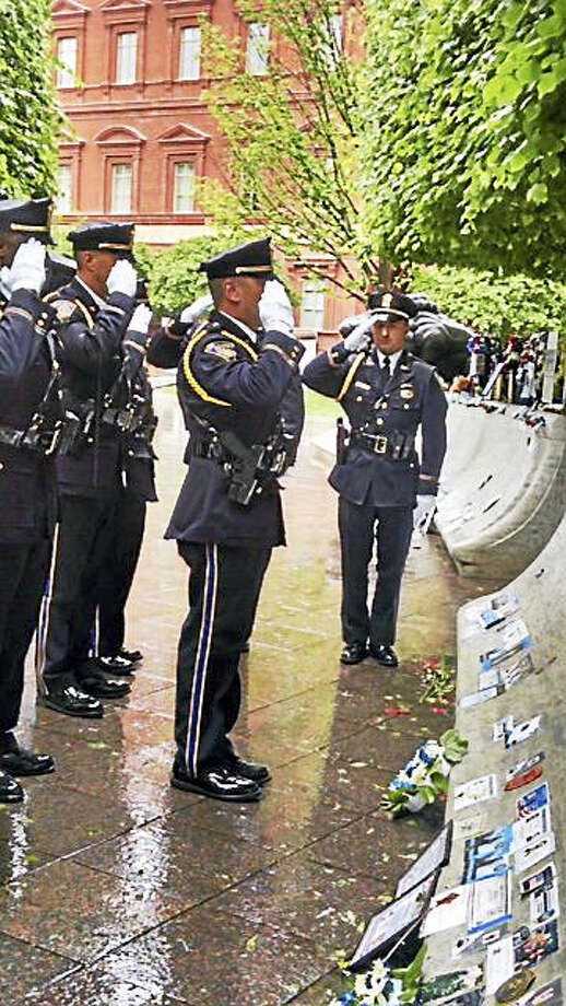 New Haven Police Chief Dean Esserman joined the family of a fallen department Detective Andrew Faggio last weekend as the officer's name was added to a police memorial wall in Washington. Contributed Photo: Journal Register Co.