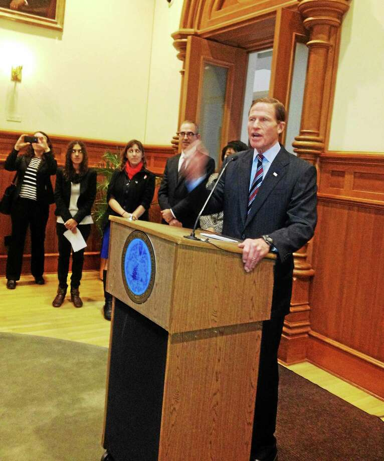 Mary O'Leary - New Haven Register) U.S. Sen. Richard Blumenthal, D-Conn., addresses rally inside City Hall Thursday Photo: Journal Register Co.