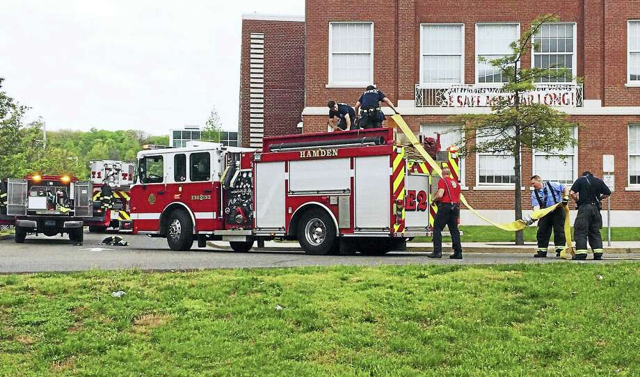 (Wes Duplantier/The New Haven Register) Hamden High School was evacuated and a teacher suffered a minor injury Friday morning after a stove fire broke out on the nursery's stove. Students were allowed back in the school about an hour later. Photo: Journal Register Co.