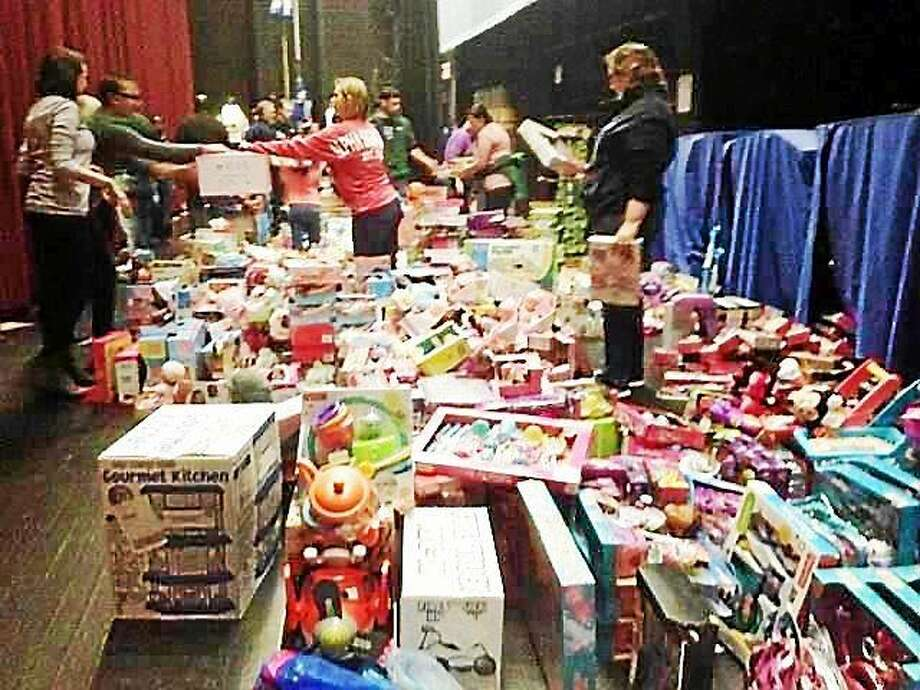 """The New Haven Police Department P.A.L. and Southern Connecticut State University sponsored a """"Friends of Rudolph"""" event Sunday that drew about 1,200 children. Santa visited as well. Photo: Journal Register Co."""
