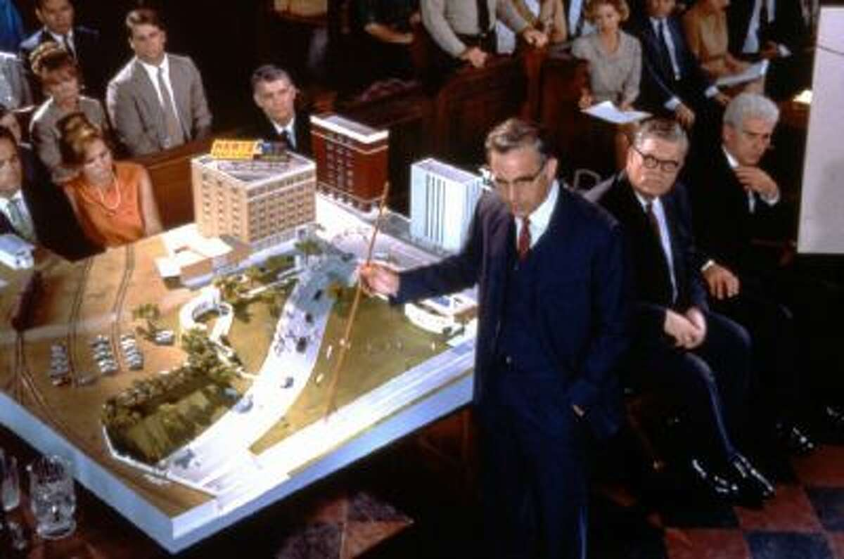 """This image provided by Warner Bros. from Oliver Stone's 1991 movie """"JFK"""" shows Kevin Costner as New Orleans District Attorney Jim Garrison demonstrating the """"magic bullet"""" theory."""