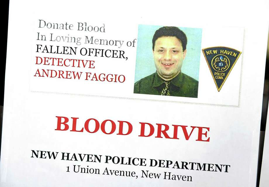 (Arnold Gold-New Haven Register)  A sign at the New Haven Police Department advertises a blood drive at the department in memory of fallen Detective Andrew Faggio on 9/1/2015. Photo: Journal Register Co.