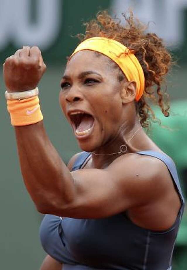 In this June 8, 2013 file photo, Serena Williams, of the U.S, celebrates a winning point as she plays Russia's Maria Sharapova during the Women's final match of the French Open tennis tournament at the Roland Garros stadium in Paris. Williams is The Associated Press' 2013 Female Athlete of the Year, easily winning a vote by news organizations.