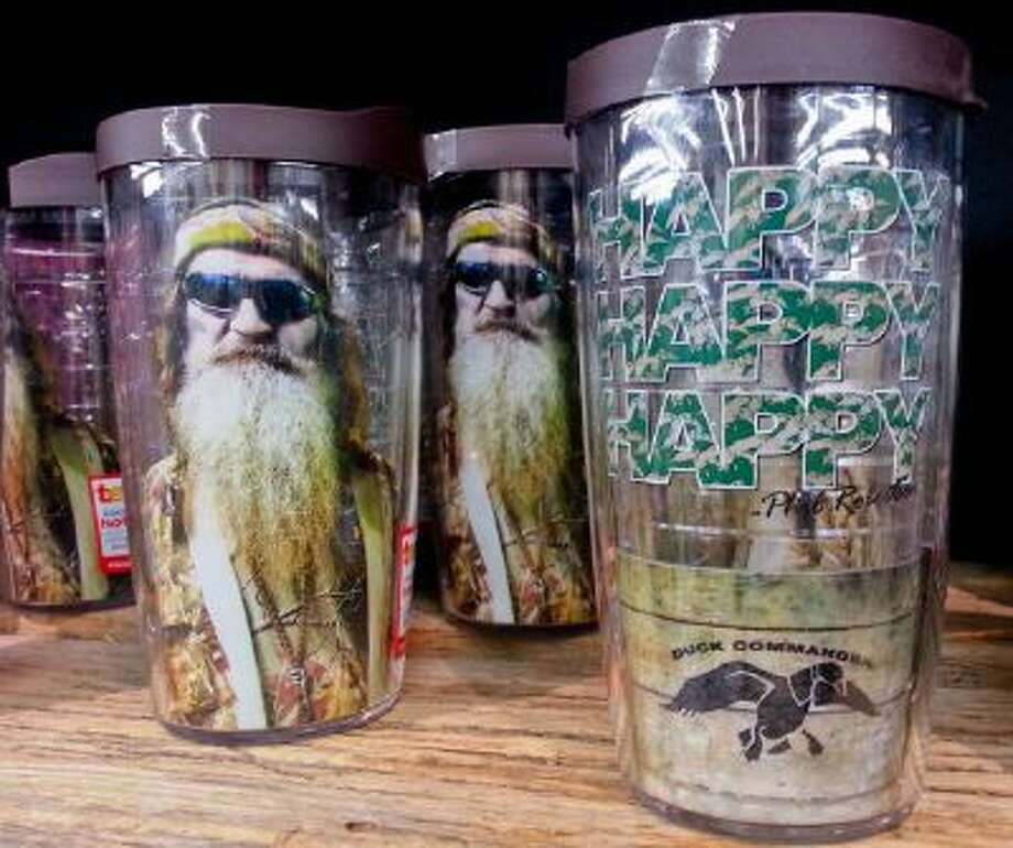 """This Saturday, Dec. 21, 2013 photo shows items showing the image of Phil Robertson and his catchphrase """"Happy, Happy, Happy"""" displayed at the Duck Commander store in West Monroe, La."""