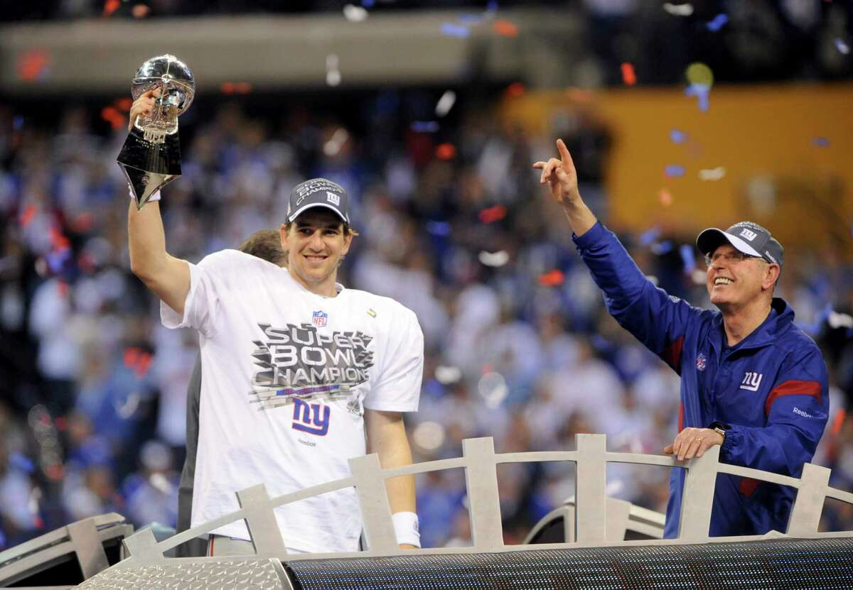 New York Giants quarterback Eli Manning and Giants coach Tom Coughlin with the Vince Lombardi Trophy after winning Super Bowl XLVI at Lucas Oil Stadium in Indianapolis, on Feb. 5, 2012. The Giants won 21-17. (Barton Silverman/The New York Times)