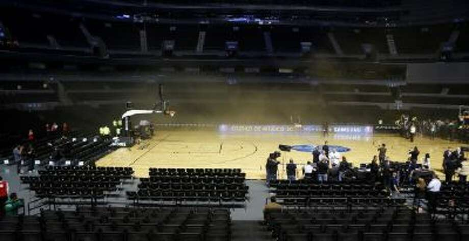 The court at The Mexico City arena is engulfed by smoke.