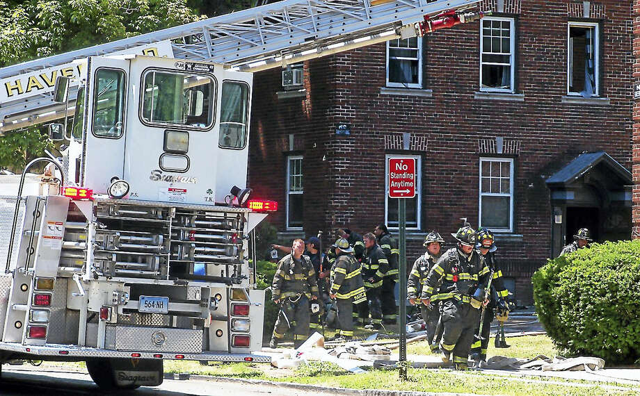 (Wes Duplantier/The New Haven Register)People were displaced from 10 apartment units after a two-alarm fire broke out at 202 Sherman Ave. No one was hurt in the fire but part of Sherman Avenue was shut down for hours as crews put out the flames, cleaned up and investigated. Photo: Journal Register Co.