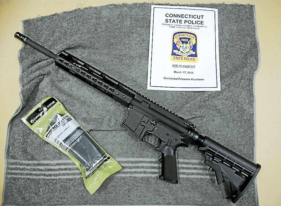 (Photo courtesy of the Connecticut State Police)A Connecticut man is facing several charges after investigators allegedly found dozens of weapons and thousands of rounds of ammunition in his New Fairfield home. Photo: Journal Register Co.