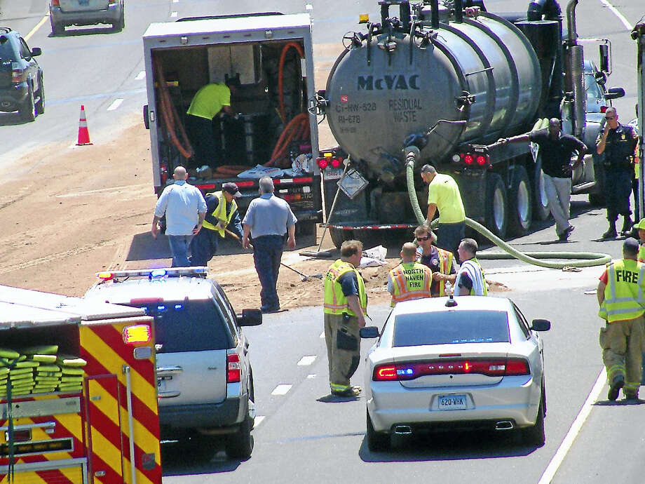 (Wes Duplantier/The New Haven Register) Part of Interstate 91 southbound was shut down for nearly two hours Monday after a tractor trailer crash that caused a fuel spill. The closure caused significant delays on local roads near highway on-ramps. Photo: Journal Register Co.