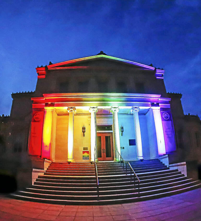 John Vanacore - For The RegisterBranford's Blackstone Library was it up in memory of the Orlando terrorist attack victims Monday night at the conclusion of a vigil held in the Branford center. Photo: Journal Register Co. / John Vanacore/Register