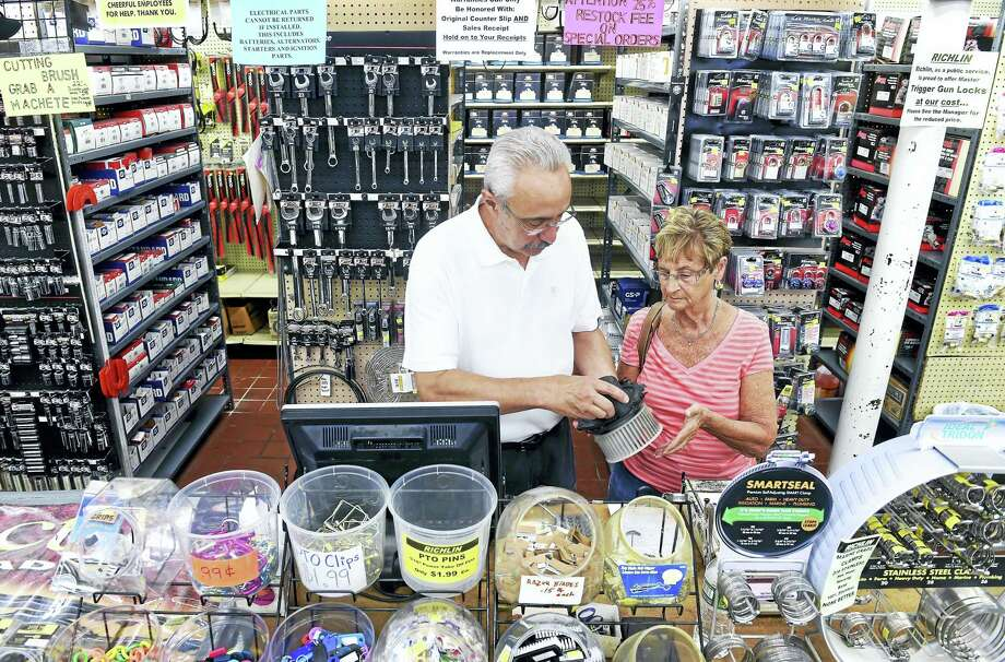 (Arnold Gold-New Haven Register)  Store manager Steve Milano assists Peggy Pongonis of Branford with a car part at the Richlin hardware/automotive/home and garden store in Branford on 6/7/2016. Photo: Journal Register Co.