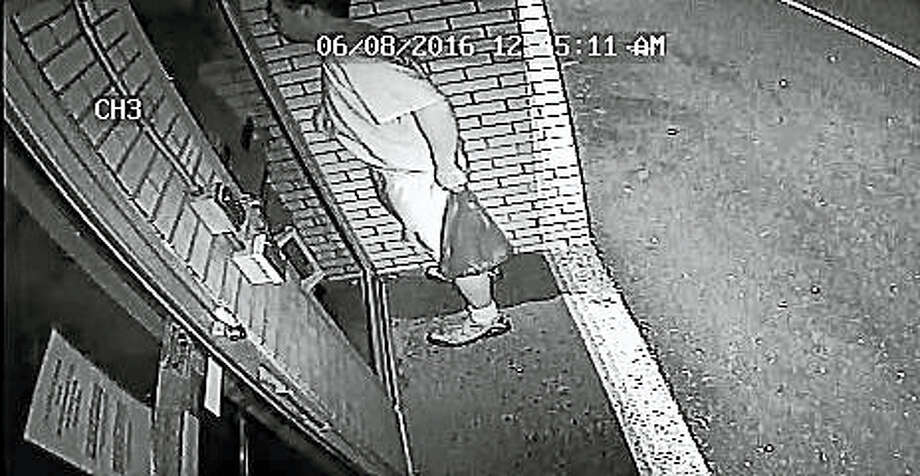 (Photo courtesy of New Haven Police Department)  Police are looking for this man who they say has been painting obscene graffiti on buildings in a city neighborhood. Photo: Journal Register Co.