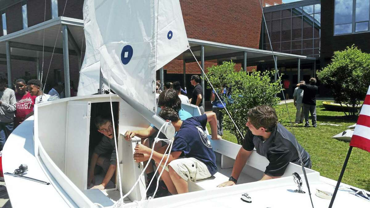 Kate Ramunni - New Haven Register Students check out the sailboat constructed as part of Hamden Middle School's Navigator program.