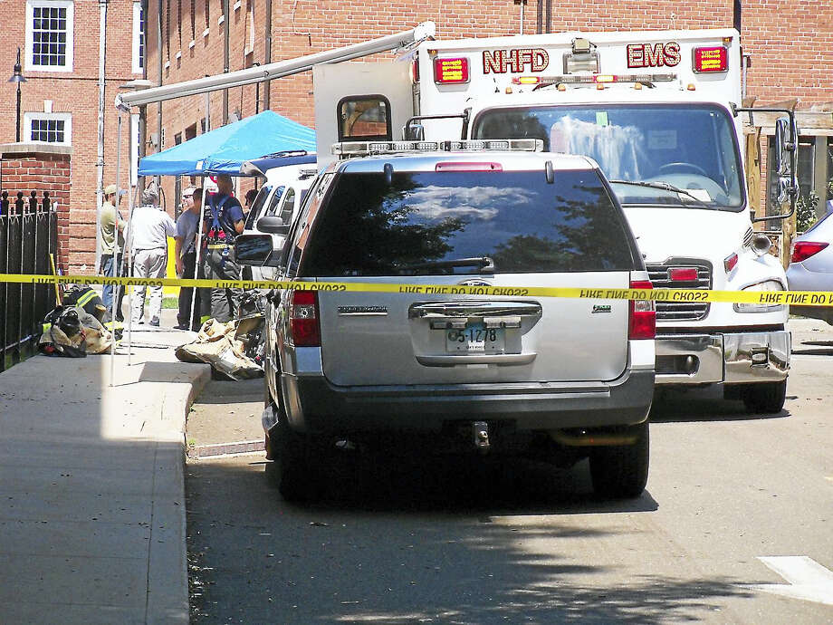 (Wes Duplantier/The New Haven Register)The Johnson Laboratory on Huntington Street in New Haven was evacuated Thursday after an unknown liquid was found leaking from a package in its basement. Photo: Journal Register Co.