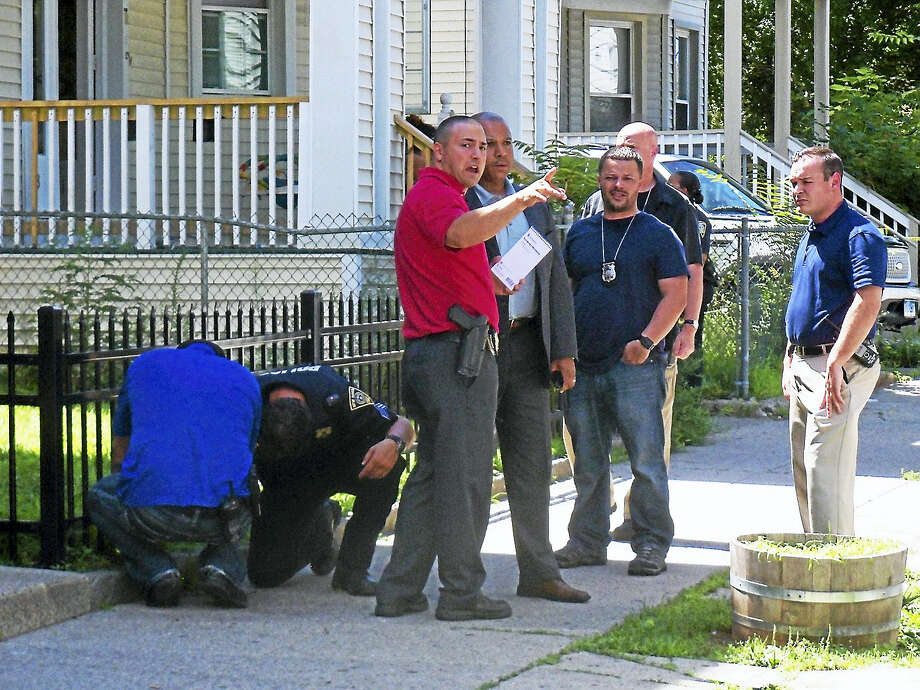 (Wes Duplantier/The New Haven Register)New Haven police were investigating after a shooting late Wednesday morning that left one person in the hospital. Photo: Journal Register Co.
