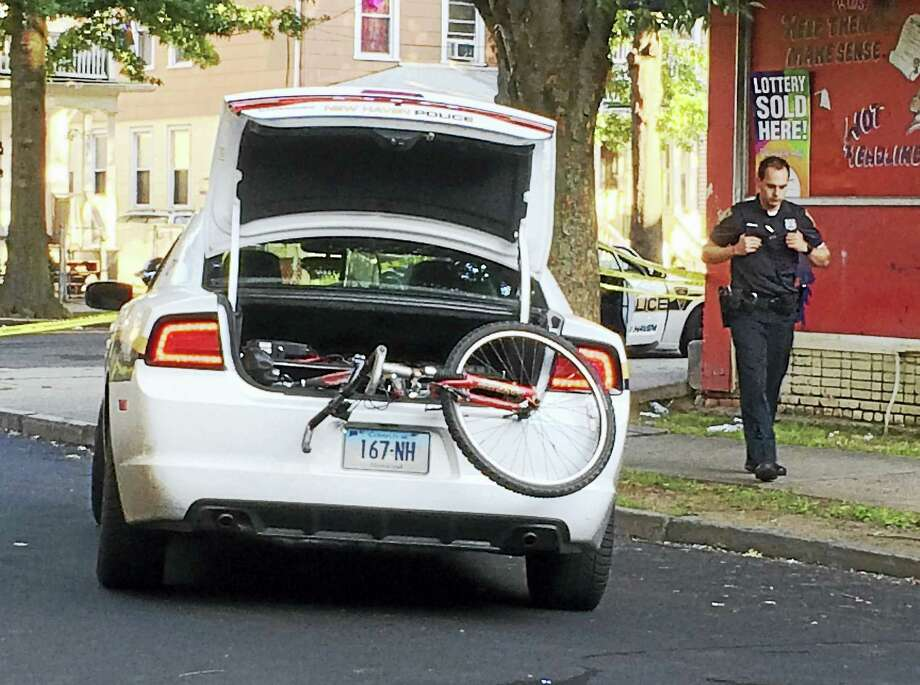 (Wes Duplantier/The New Haven Register)The intersection of Shelton and Read streets was shut down and New Haven police were investigating after a shooting that wounded a woman, 59. Police say she was in a nearby home when she was hit by stray gunfire. Photo: Journal Register Co.