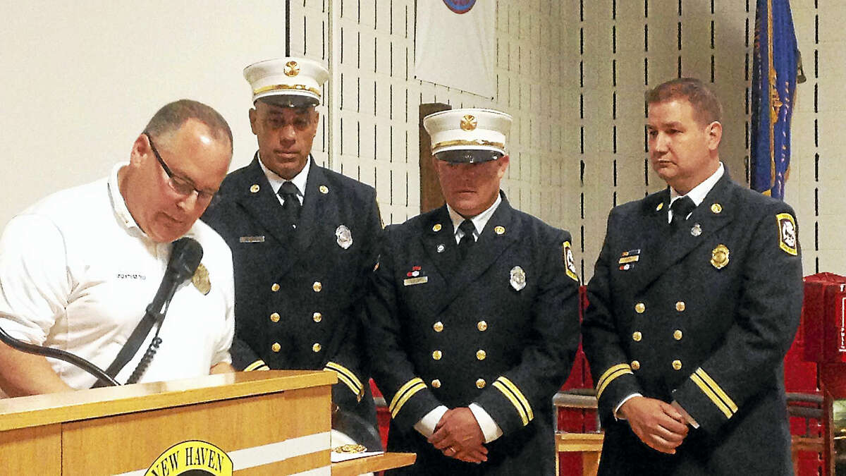 From l to r, Acting Chief Matthew Marcarelli, battalion chiefs Mark Vendetto, Tim Keiley, and Frank Ricci during a promotional ceremony Tuesday at the New Haven Fire Department Academy. Juliemar Ortiz - New Haven Register