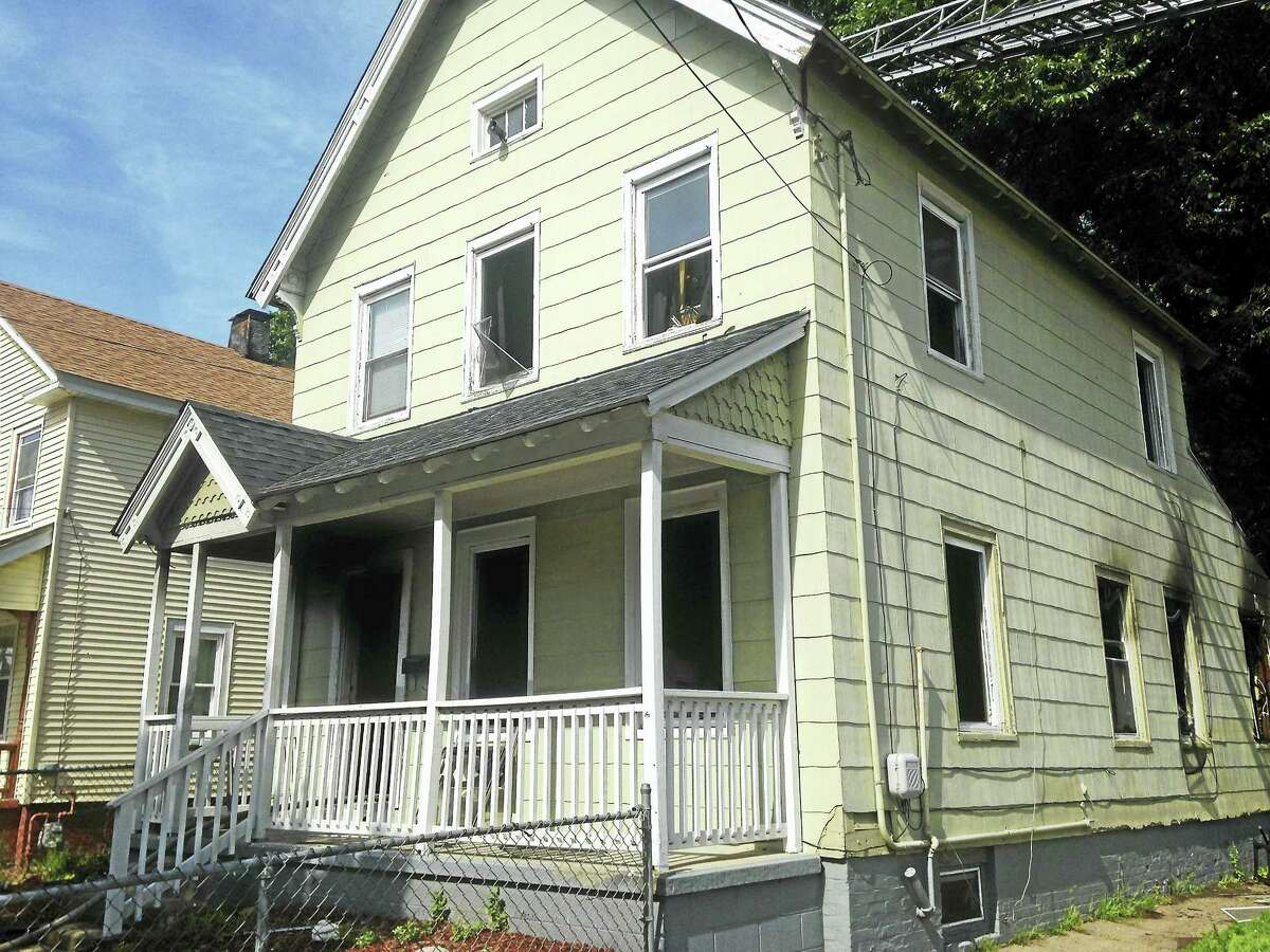 (Juliemar Ortiz - New Haven Register) House fire at 617 Dixwell Ave. Saturday afternoon.
