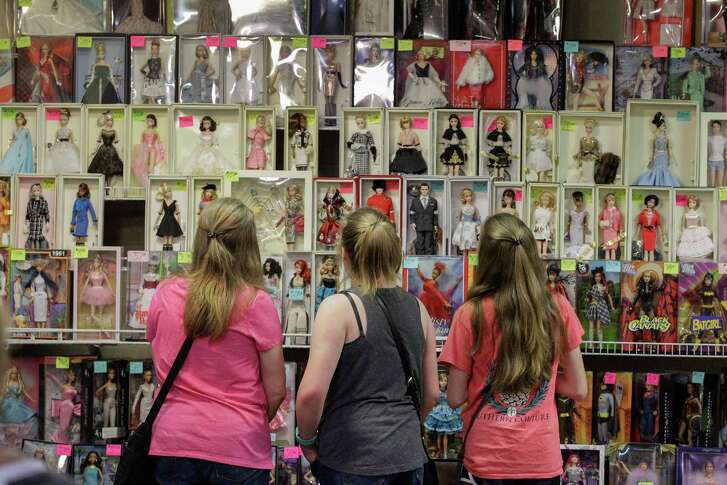 Stephanie Schrull (left-rift) brought her daughters Brooke, 12, and Brienne, 16, to the 2017 National Barbie¨ Doll Collectors Convention Saturday, July 22, 2017, at the Hyatt Regency Downtown Houston in Houston. Schrull wanted her daughters to know how much Barbie¨ collecting was a part of her youth. Members of the Houston Doll Society, in conjunction with the National Collectors Convention Steering Committee, sponsored the 2017 National Barbie¨ Doll Collectors Convention.
