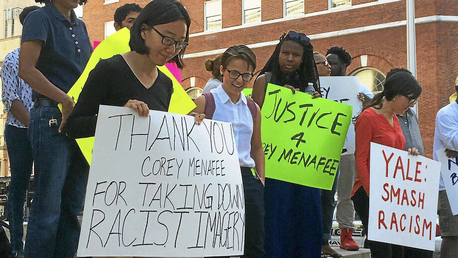 (Wes Duplantier/The New Haven Register) Dozens of people protested Tuesday outside New Haven Superior Court, 121 Elm St., to show their support for former Yale worker Corey Menafee. Menafee resigned from the university and was criminally charged after he allegedly broke a window display depicting slavery at Calhoun College. Photo: Journal Register Co.