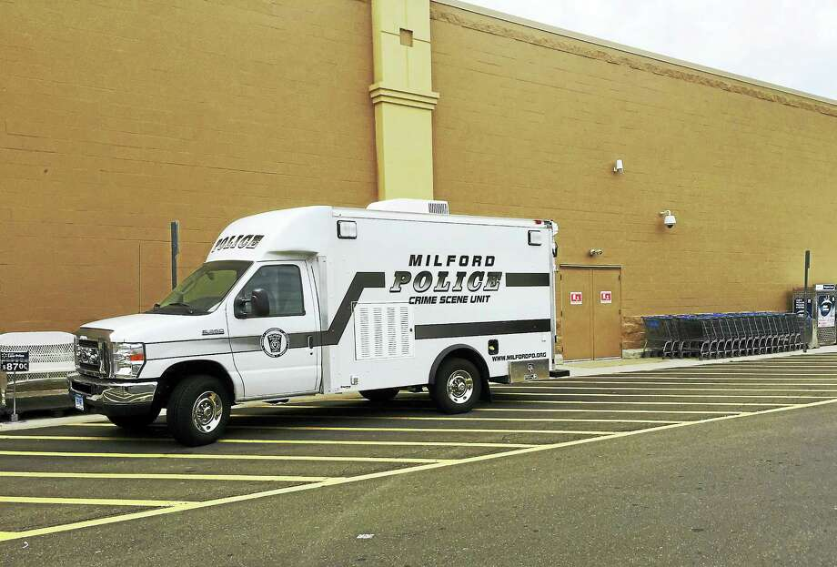 (Phyllis Swebilius/The New Haven Register)Milford police were investigating Thursday morning after an incident at the Walmart, 1365 Boston Post Road. The store was closed but Walmart confirmed all employees and customers were unharmed. Photo: Journal Register Co.