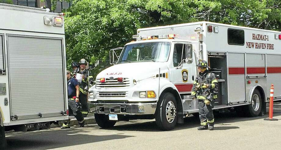 (Wes Duplantier/The New Haven Register)New Haven firefighters, police officers and several other agencies responded to a lab accident Monday morning at the Science Park in New Haven. Photo: Journal Register Co.
