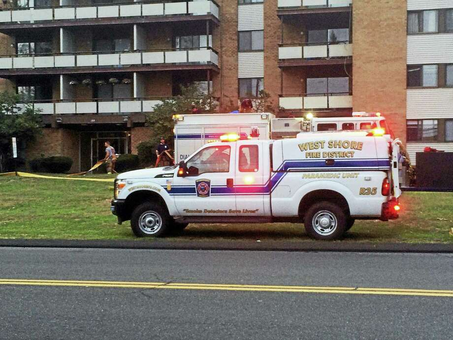 (Wes Duplantier/The New Haven Register)State and local fire marshals were investigating Monday after an early morning fire at the Orange Landing condominiums on Bull Hill Lane in West Haven that left one man dead. Photo: Journal Register Co.