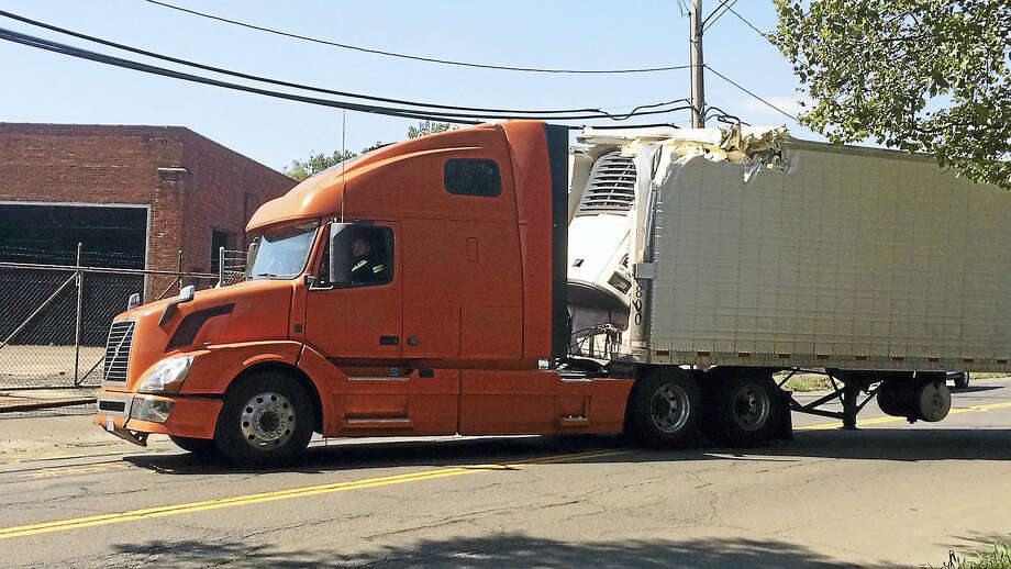 (Wes Duplantier/The New Haven Register)Part of James Street was shut down for more than an hour Wednesday after a tractor-trailer crashed into a rail bridge. No one was hurt in the accident, which briefly suspended rail service. Photo: Journal Register Co.