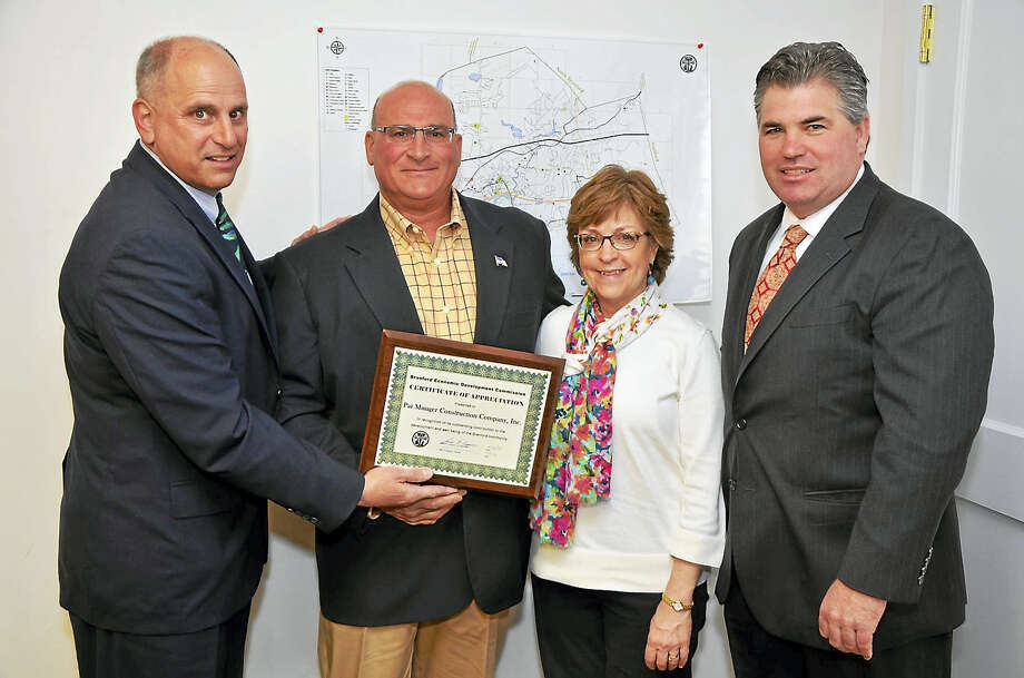 CONTRIBUTED PHOTO - Bill O'BrienFrom left, EDC chairman Perry Maresca, Munger Construction President David DeMaio, Vice President Pam DeMaio, and Branford First Selectman Jamie Cosgrove. Photo: Journal Register Co.