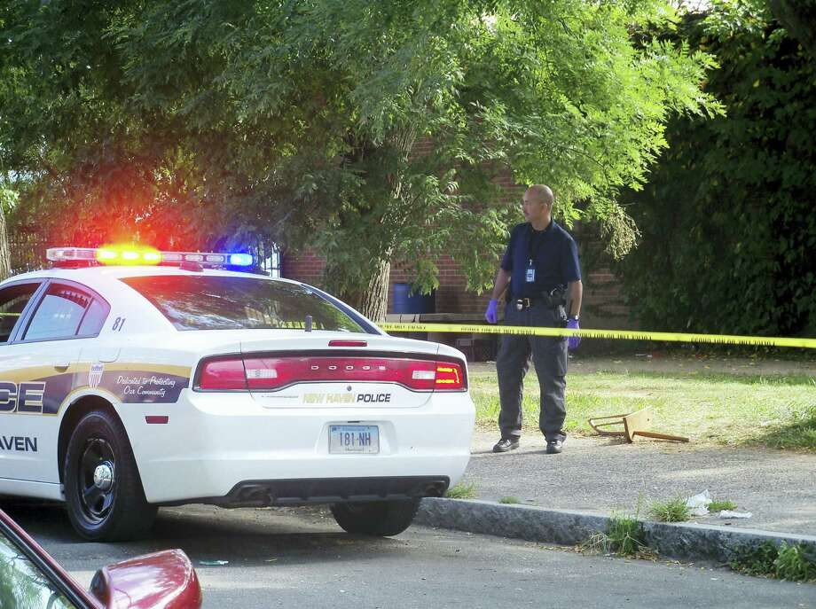 (Wes Duplantier/The New Haven Register)New Haven police were investigating on Burwell Street and at the Farnam Courts housing complex after a man was stabbed Friday morning. The man, 29, was stabbed three times, including once in the neck. Photo: Journal Register Co.