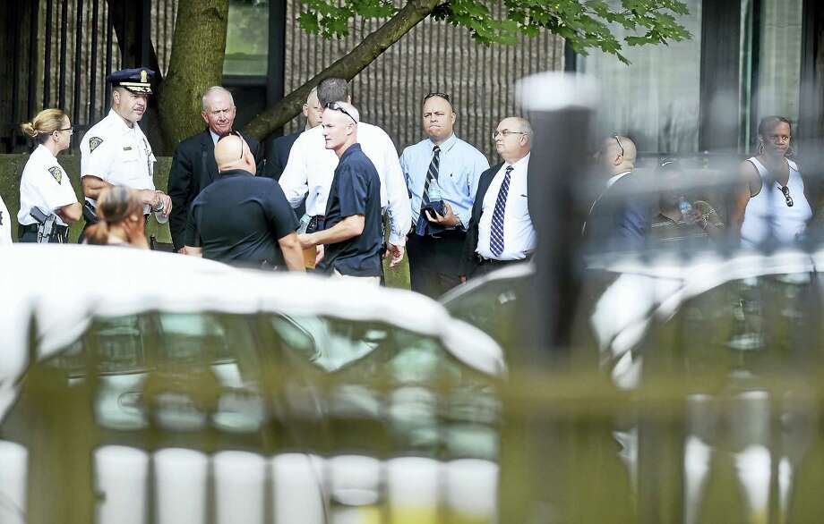(Arnold Gold-New Haven Register)  New Haven Police investigate the scene at Matthew Ruoppolo Manor on Ferry St. in New Haven where a man was shot by police on 8/16/2016. Photo: Journal Register Co.