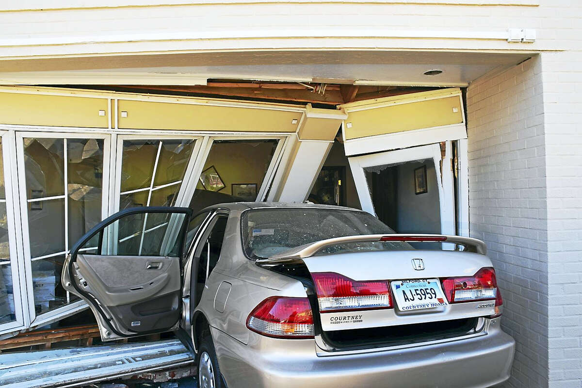 (Photo courtesy of the Milford Fire Department)One person was hurt Tuesdy morning after their car crashed into a building at 250 Broad St. One person was in the building but was not injured.