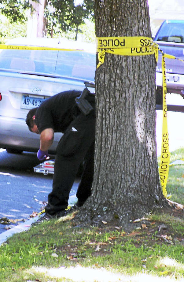 (Wes Duplantier/The New Haven Register)A Guilford man was taken the hospital Tuesday morning after he was shot on Mansfield Street in New Haven. Police said the man's injury was not considered life-threatening. Photo: Journal Register Co.
