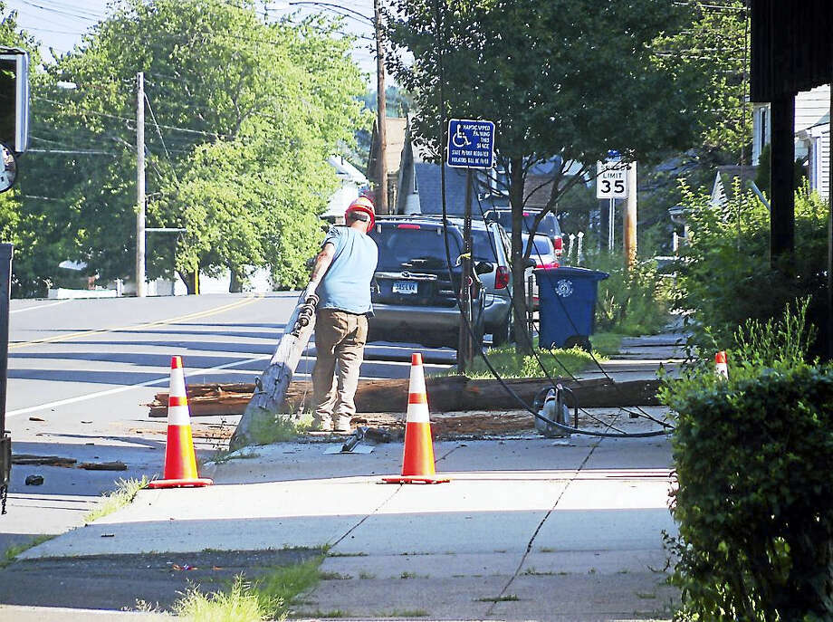 (Wes Duplantier/The New Haven Register) Part of State Street was shut down for about an hour Monday morning near the New Haven-Hamden line after a crash that took out a utility pole and wires. Photo: Journal Register Co.