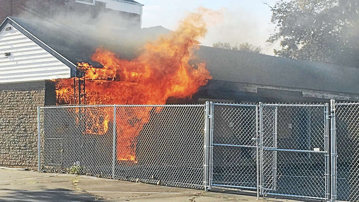 Wes Duplantier/New Haven RegisterA fire broke out late Monday afternoon at the Debonair Beach Motel on Beach Street in West Haven. The flames were knocked down within minutes and damaged one corner of the hotel.