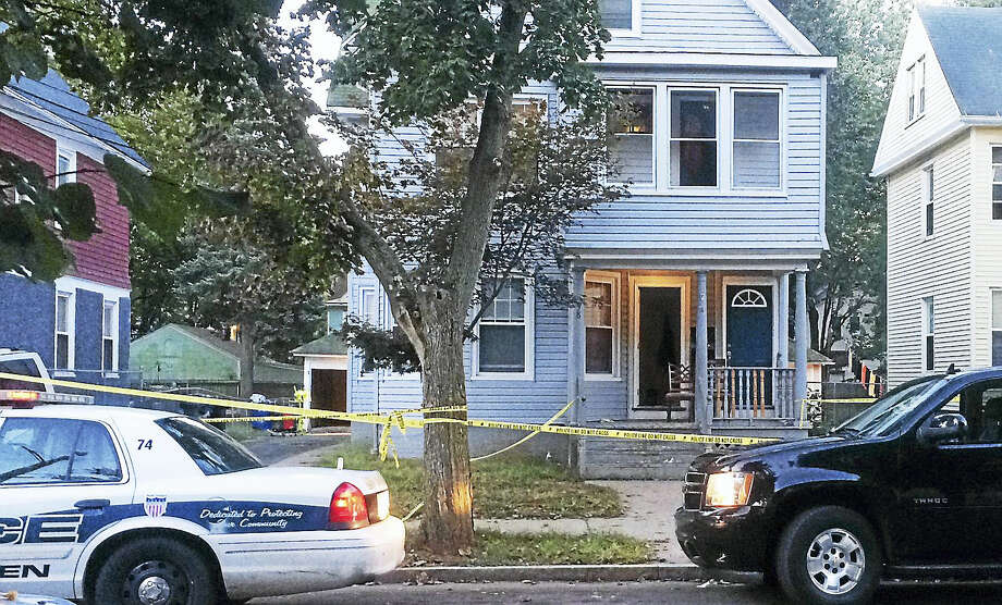 (Wes Duplantier/The New Haven Register)City police were continuing to investigate early Thursday after a shooting on Dorman Street left a New Haven man dead. Photo: Journal Register Co.