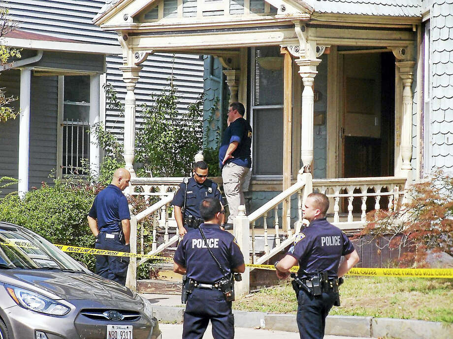 (Wes Duplantier/The New Haven Register)New Haven police were investigating after a man was shot in the leg late Wednesday morning inside a home on George Street. Police say there was some kind of altercation in the house before the man was hurt. Photo: Journal Register Co.