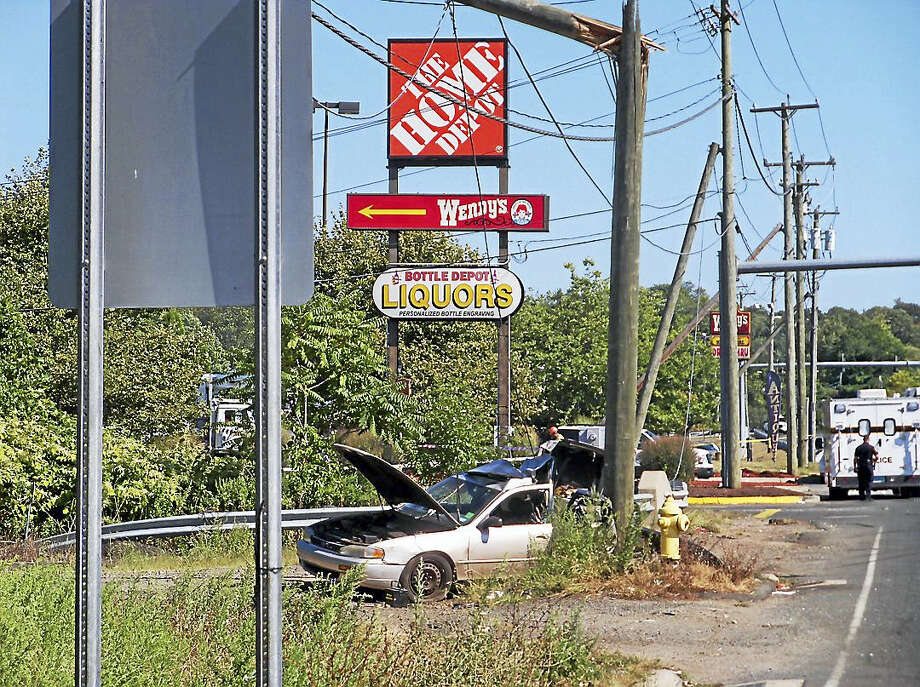 (Wes Duplantier/The New Haven Register)Part of Frontage Road in East Haven was shut down Wednesday after a silver car crashed into a utility pole. The accident near Home Depot completely closed a half-mile stretch of road for hours. Photo: Journal Register Co.