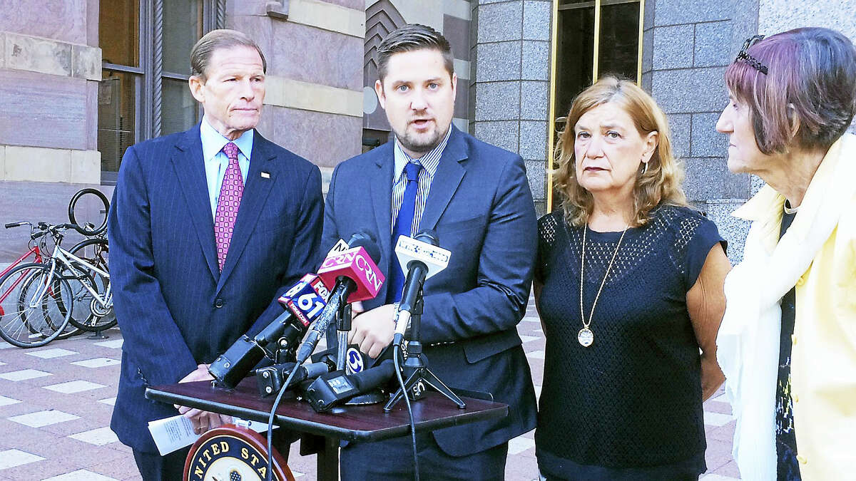 (Wes Duplantier/The New Haven Register)Speaking Monday near the federal courthouse in New Haven, U.S. Sen. Richard Blumenthal, D-Conn., and U.S. Congresswoman Rosa DeLauro, D-3, called on President Barack Obama to sign legislation to allow the families of 9/11 victims to sue foreign actors. They were joined by Brett and Gail Eagleson, the son and wife of Bruce Eagleson, who died in the attacks.